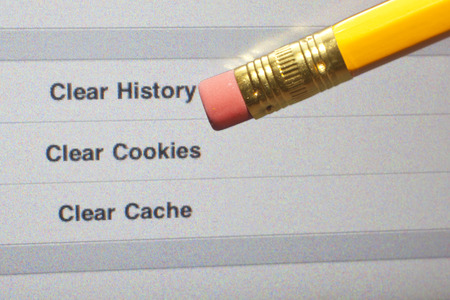 computer virus: An eraser pointing to a clear internet history options on a computer screen.