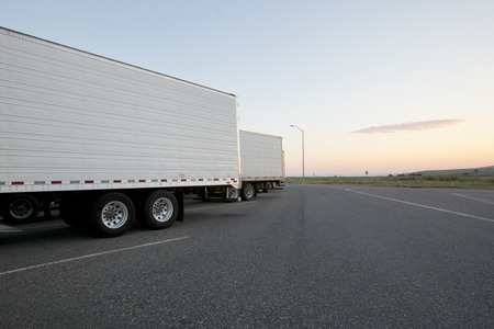 18 wheeler: Sunrise at a truck stop Stock Photo