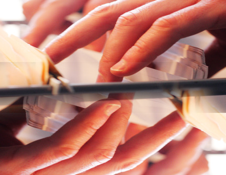 manipulate: Abstract design of hands searching through a filing cabinet. Stock Photo