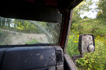 A detail of a muddy 4x4 off road vehicle. Stock Photo