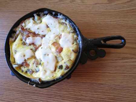 omlet: An omelet served in a small cast Iron Skillet.