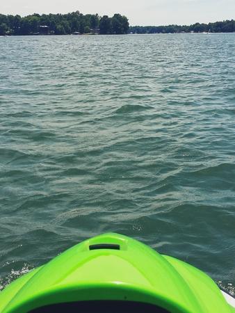 jetski: A waverunner jet ski on a lake.