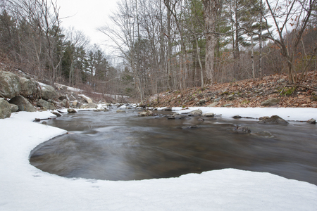 A winter scene of Indian Brook flowing through Red Rock, New York. Stock Photo