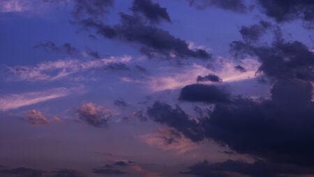 A view of a cool toned twilight sky.