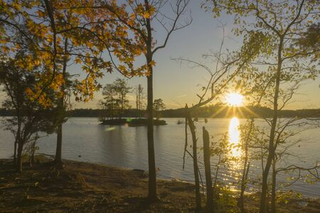 A scenic autumn view of a sunset over Lake Norman in North Carolina.
