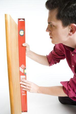 carpenter's sawdust: a guy aligning something Stock Photo