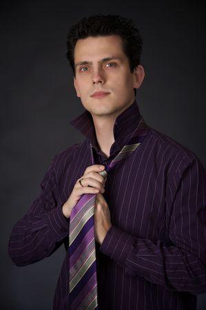 successfull: A guy adjusting his tie