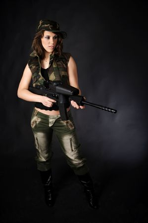 Sexy Girl with paintball marker photo