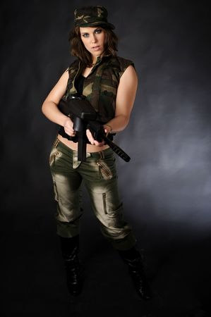 Girl with paintball marker photo