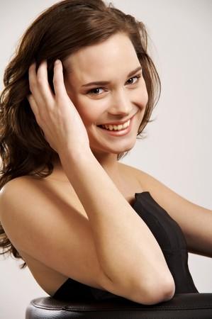 Beautiful young woman smiling photo