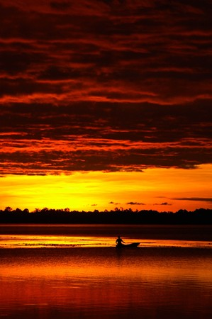 lowboat on the lake with sunset Stock Photo - 7039057