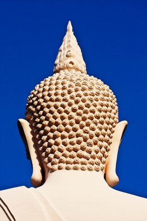white buddha on the mountain photo