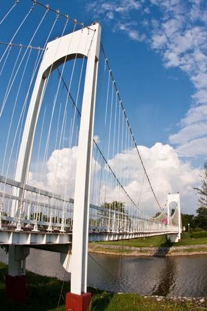 white bridge with blue sky photo