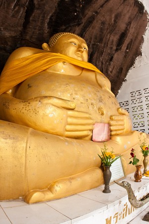 subduing: gold buddha in the temple