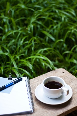 coffee and note in garden.
