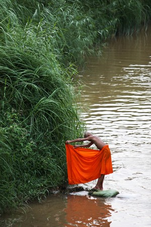 monk on the river photo