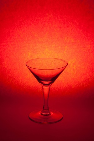 glass on red background photo