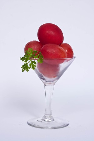 tomato in glass on white background photo