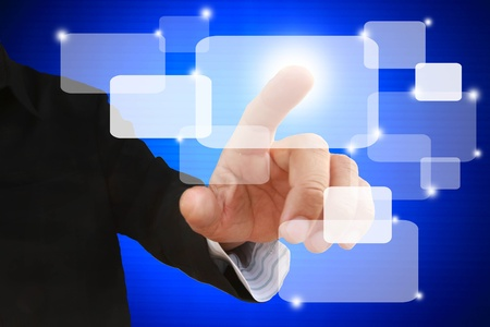 hand of business man touch on blue touchscreen Stock Photo - 9552973