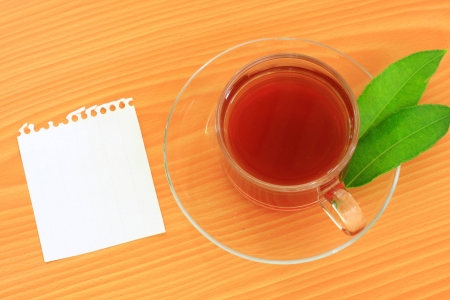 paper note and green tea photo