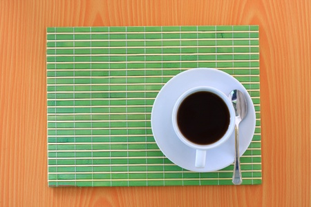 white coffee on green bamboo mat photo