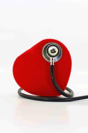 red heart and stethoscope on white background photo
