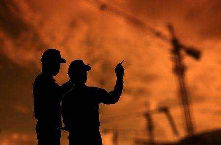 industrial sites: silhouette of construction man Stock Photo