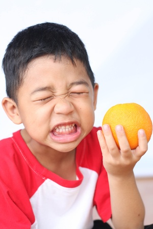 expression facial: boy sour Stock Photo