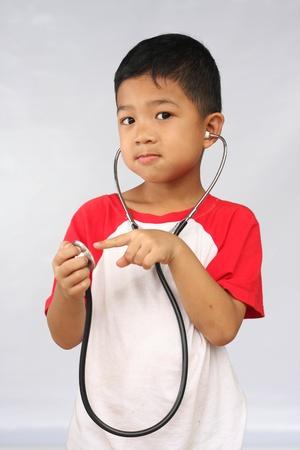 asian boy with stethoscope photo