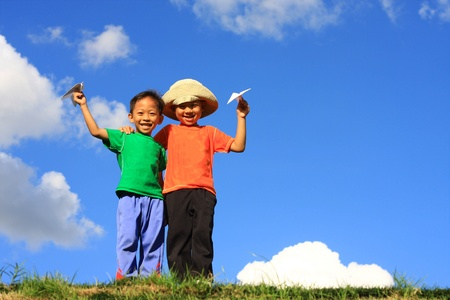 two boy with paper airplane photo