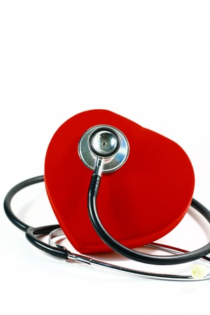 red heart ane stethoscope on white background photo