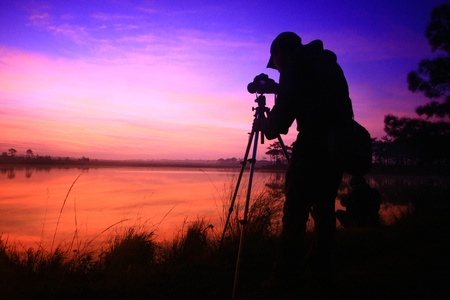 photographer with sunset photo