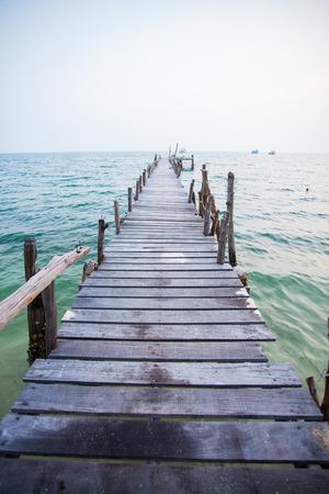 wood bridge on the sea photo