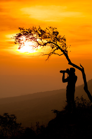 Silhouette of a photographer man