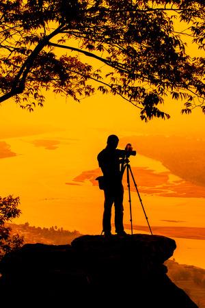 Silhouettes of the man take a photo  photo