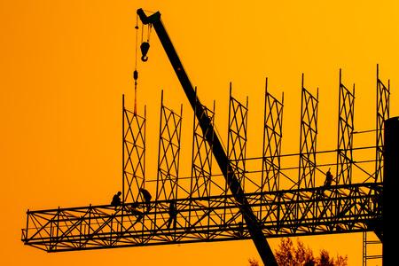 Silhouettes of men running the installer billboard advertising  photo