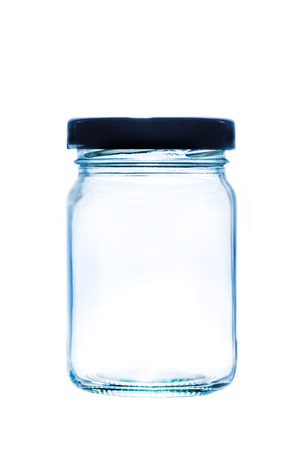 Glass jar with lid on a white background
