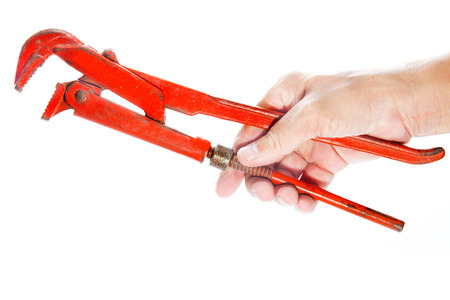 alligator wrench: Man s hand holding a red spanner on a white background
