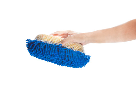 Man s hand holding a sponge to wash your car on a white background  photo