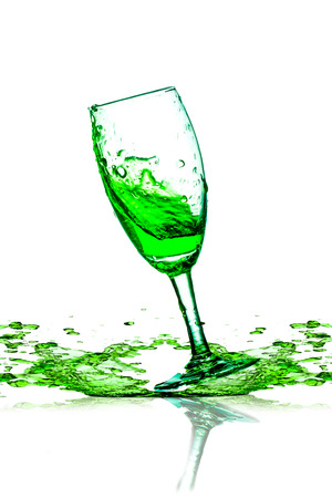 green beverage splash out of the glass  photo