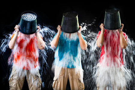 water bucket: man pour a bucket of ice, put yourself on a black background
