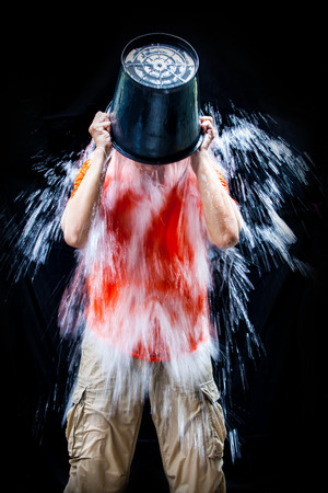 challenge: man pour a bucket of ice, put yourself on a black background