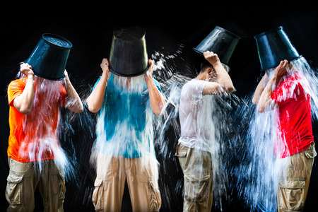 man pour a bucket of ice, put yourself on a black background  photo
