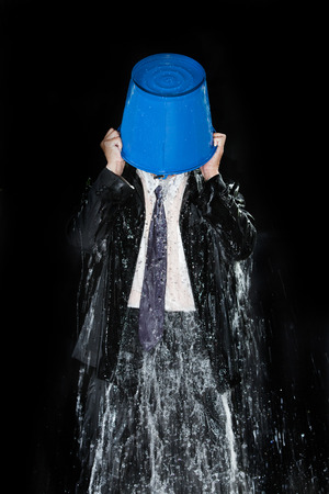 pour: Man pour out bucket of water pouring himself. Stock Photo