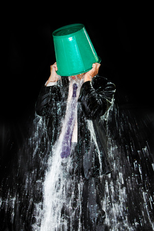 pour water: Man pour out bucket of water pouring himself. Stock Photo