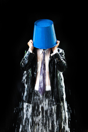 work popular: Man pour out buckets of water pouring himself. Stock Photo