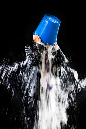 pour: Man pour out buckets of water pouring himself. Stock Photo