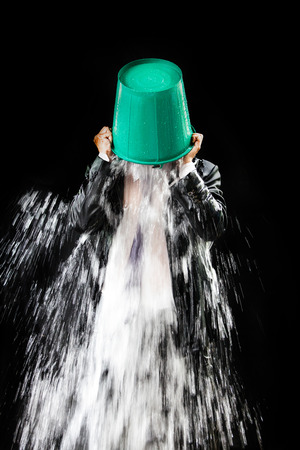 pour water: Man pour out buckets of water pouring himself. Stock Photo