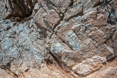 dark slate gray: The surface of the rock cracks.