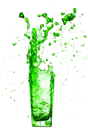 gree: gree water splash from glass on white background.